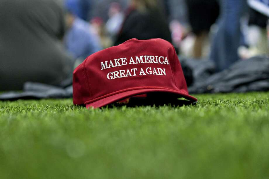 """A """"Make America Great Again"""" hat sits on the ground ahead of a speech by U.S. President Donald Trump, not pictured, during a rally in Washington, Michigan, U.S., on Saturday, April 28, 2018. Trump took on most of his usual targets at a campaign-style rally on Saturday, including Democrats, the media and former FBI Director James Comey, and urged his supporters to vote in midterm elections to prevent a rollback of his policies. Photographer: Daniel Acker/Bloomberg Photo: Daniel Acker / © 2018 Bloomberg Finance LP"""