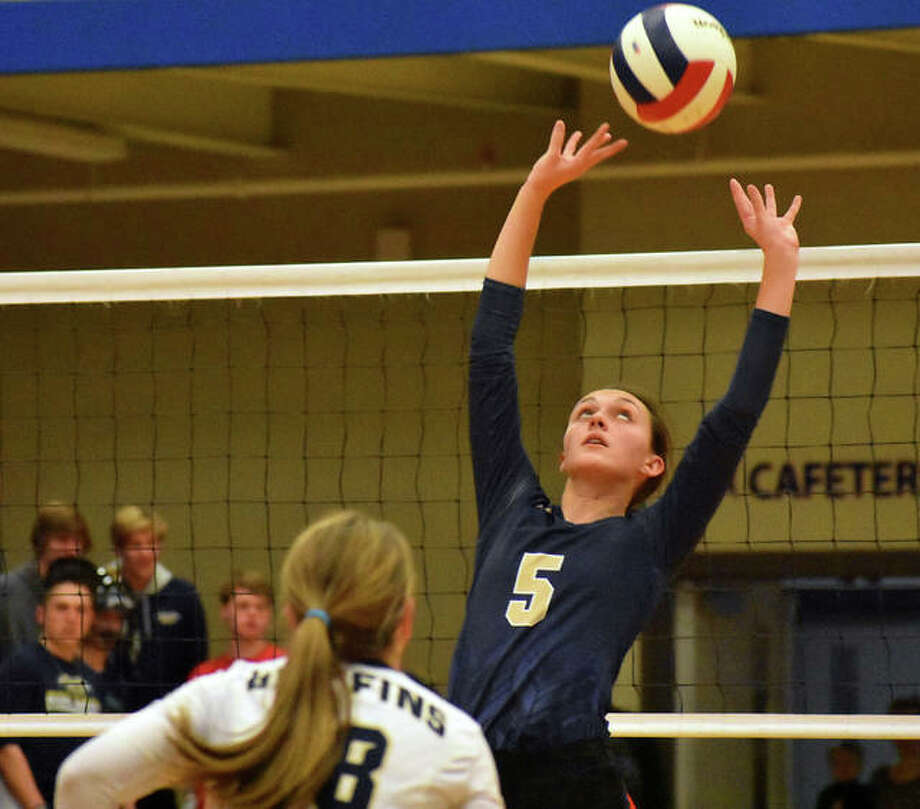 Father McGivney setter Claire McKee delivers a pass in the second game against Grayville at the Class 1A Okawville Super-Sectional on Friday.