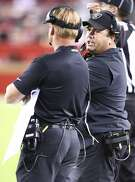 Oakland Raiders defensive coordinator Paul Guenther, right, talks with head coach Jon Gruden during the second half of an NFL football game against the San Francisco 49ers in Santa Clara, Calif., Thursday, Nov. 1, 2018. (AP Photo/Ben Margot)