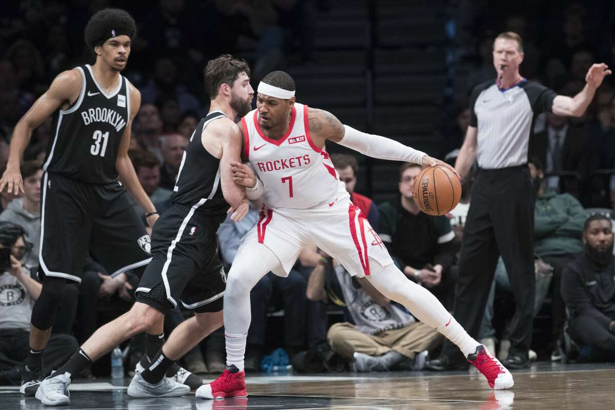 Houston Rockets forward Carmelo Anthony (7) drives to the basket against Brooklyn Nets forward Joe Harris during the second half of an NBA basketball game, Friday, Nov. 2, 2018, in New York. (AP Photo/Mary Altaffer)