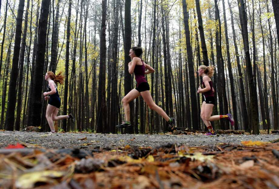 Class B division runners in the Section II Cross Country Championships head out of the woods at Saratoga Spa State Park on Friday, Nov. 2, 2018, in Saratoga Springs, N.Y. (Will Waldron/Times Union) Photo: Will Waldron / 40045357A