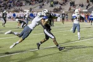 Justin Hammond (4) scores a touchdown Friday night.