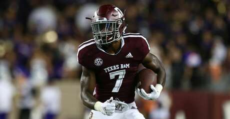 Texas A&M Aggies running back Jashaun Corbin (7) runs after catching a pass against the Northwestern State Demons during the fourth quarter of the NCAA game at Kyle Field Thursday, Aug. 30, 2018, in College Station, Texas.