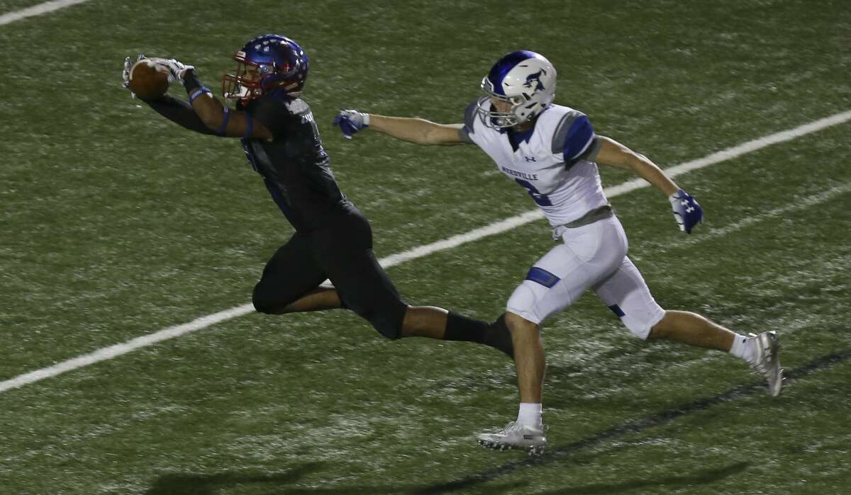 Brazosport Exporters' Christian Guevara (3) catches a pass from quarterback Daraell Preston during the second half of the game against Needville Blue Jays at Hopper Field on Friday, Nov. 2, 2018, in Freeport. The Needville Blue Jays defeated the Brazosport Exporters 14-13.