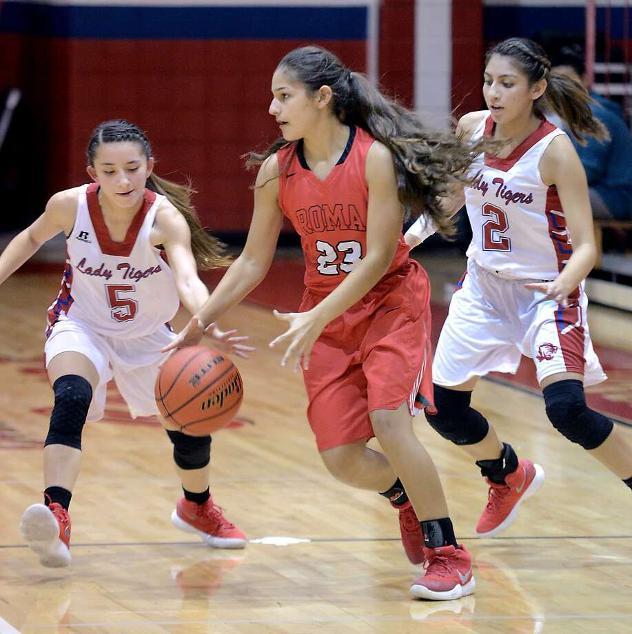 Lexi Lopez and Sylvia Rodriguez scored 17 and 11 points, respectively, helping the Lady Tigers rout Brooks Academy 70-6 on the road Friday night to begin the girls' basketball season. It's the largest Martin victory on record over the past 12 seasons. Photo: Cuate Santos /Laredo Morning Times File / Laredo Morning Times