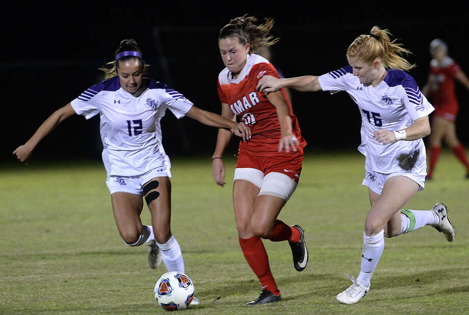 Lamar's Anna Loftus battles against the pressure of Stephen F. Austin's Katelyn Termini (left) and Breanna Moore during their Southland Conference semi-final game at Lamar.
