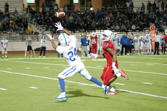 Clear Springs' Isaiah Bibb (24) prepares to pull in a pass over Clear Lake's Joey White (2) Friday at Challenger Columbia Stadium.