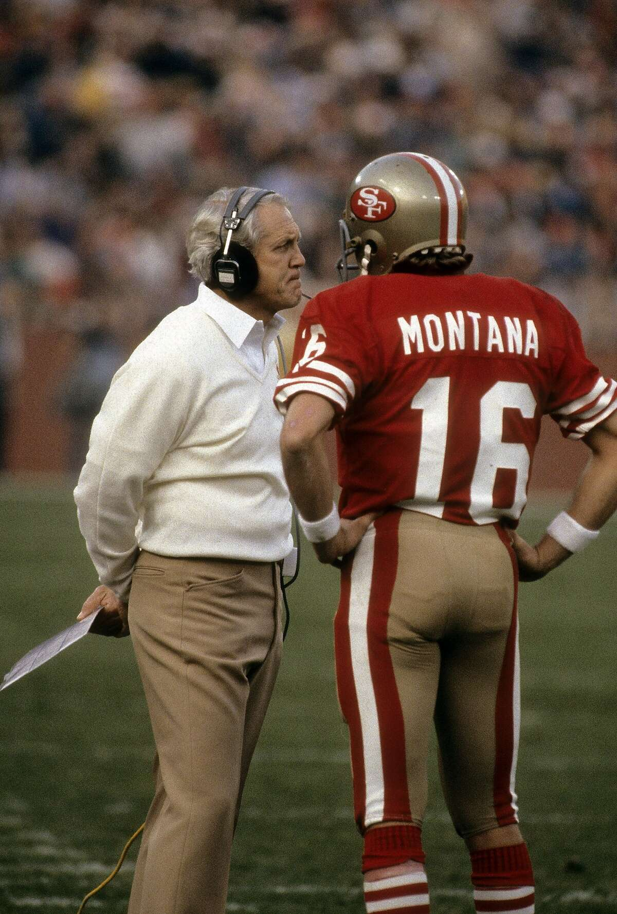 SAN FRANCISCO, CA - CIRCA 1980's:� Quarterback Joe Montana #16 of the San Francisco 49ers on the sideline talking with head coach Bill Walsh during an NFL football game mid circa 1980's at Candlestick Park in San Francisco, California. Montana played for the 49ers� from 1979-92 and Walsh coached from 1979-88. (Photo by Focus on Sport/Getty Images)