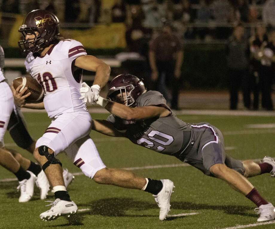 Magnolia West quarterback John Matocha (10) shakes off Magnolia defensive back Hunter Kitchens (20) during a District 8-5A (Div. I) game Friday, Nov. 2, 2018 at Bulldog Stadium in Magnolia. Photo: Cody Bahn, Houston Chronicle / Staff Photographer / © 2018 Houston Chronicle