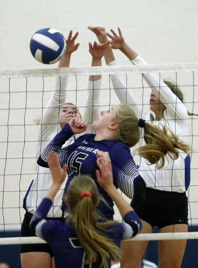 La Vernia's Alyssa Johnson,L and Addison Mulroney combine to block the slam by Navarro's Kyndall Andrews from the District 30-4A high school volleyball match between Navarro and La Vernia on Tuesday, October 16, 2018 Photo: Ronald Cortes/Contributor / 2018 Ronald Cortes