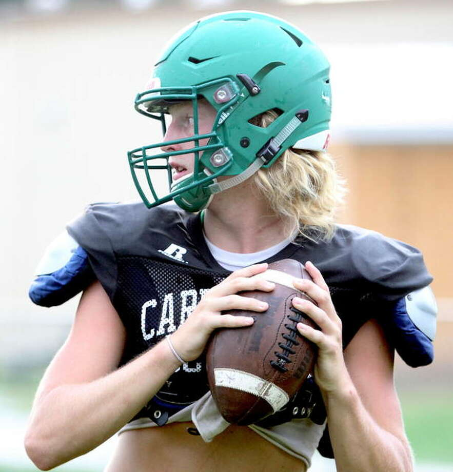 Carrollton's Hunter Flowers looks for a receiver during preseason practice. The Hawks host Camp Point Central today in the second round of the IHSA Class 1A playoffs. Photo: Dennis Mathes | Journal-Courier