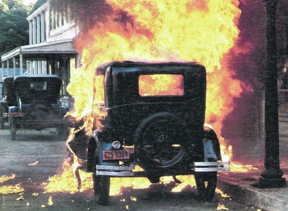 "A car explodes in a scene from the 1975 film ""Capone"" about Al Capone, whose battles for control of Chicago's bootlegging operations rocked the state in the 1920s and '30s. Photo: 20th Century-Fox 