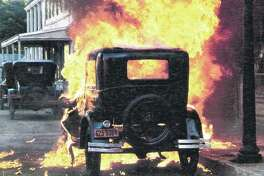 """A car explodes in a scene from the 1975 film """"Capone"""" about Al Capone, whose battles for control of Chicago's bootlegging operations rocked the state in the 1920s and '30s."""