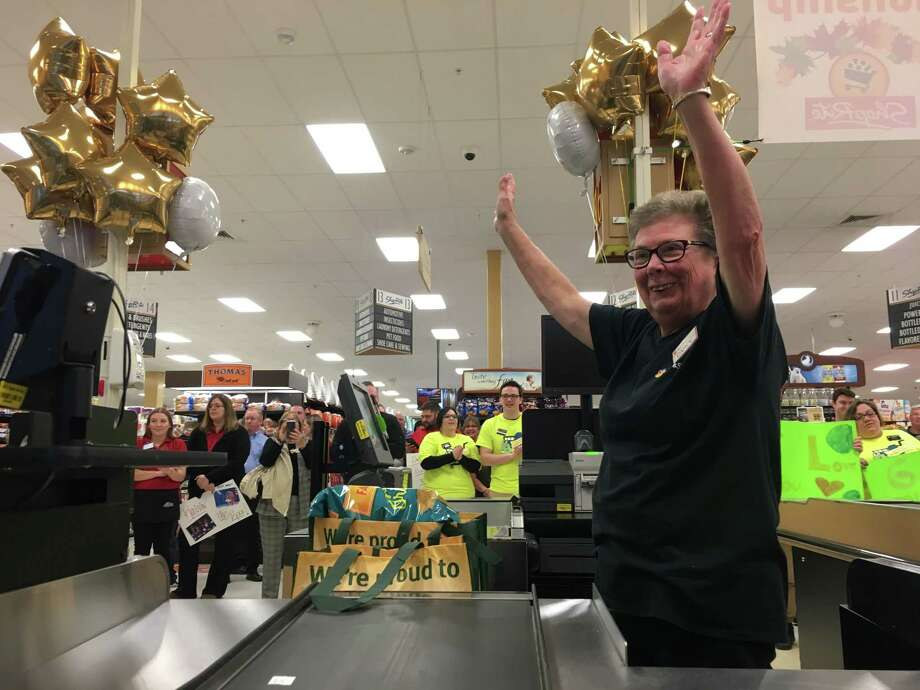 Carol Gallagher, representing the Stop and Shop grocery chain, throws her hands up after completing the first round of the New York Best Bagger competition held on Nov. 3 at the ShopRite of Slingerlands. Photo: Diego Mendoza-Moyers