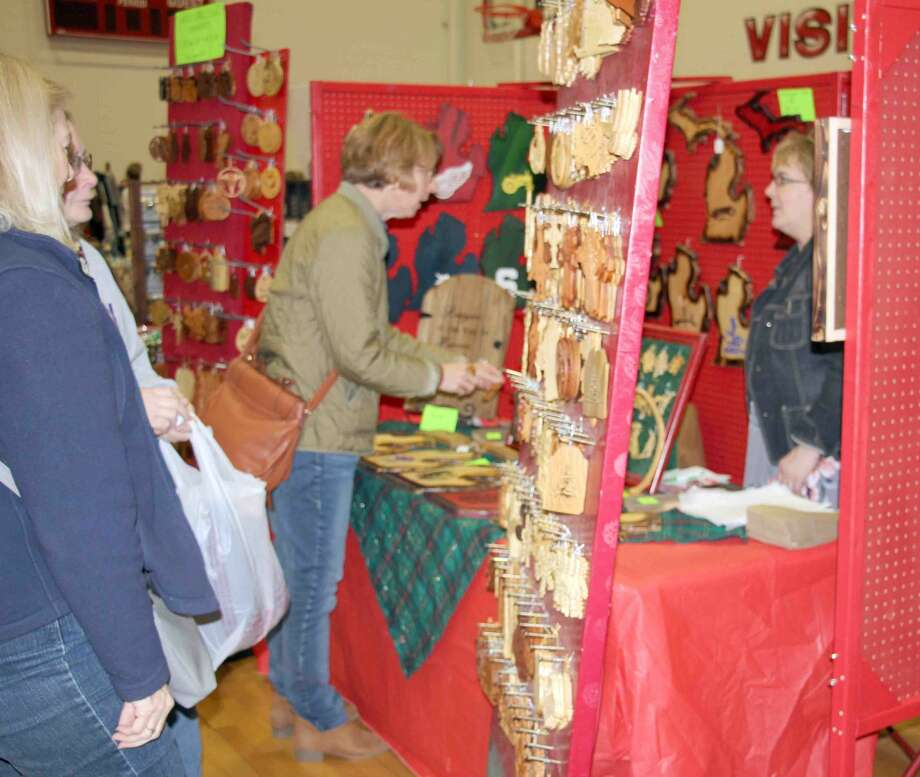 Caseville's Holly Berry Fair kicked off the holiday shopping season Saturday. This year, Holly Berry Fair is celebrating its 50th anniversary. Photo: Kate Hessling/Huron Daily Tribune