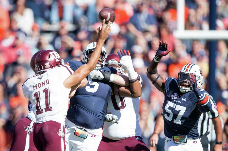 AUBURN, AL - NOVEMBER 3: Quarterback Kellen Mond #11 of the Texas A&M Aggies throws a pass over linebacker Deshaun Davis #57 of the Auburn Tigers during the first quarter at Jordan-Hare Stadium on November 3 2018 in Auburn, Alabama. Photo: Michael Chang, Getty Images / 2018 Getty Images