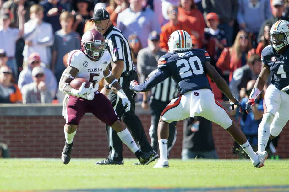 AUBURN, AL - NOVEMBER 3: Running back Trayveon Williams #5 of the Texas A&M Aggies looks to maneuver by defensive back Jeremiah Dinson #20 of the Auburn Tigers during the second quarter at Jordan-Hare Stadium on November 3 2018 in Auburn, Alabama. Photo: Michael Chang, Getty Images / 2018 Getty Images