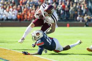 AUBURN, AL - NOVEMBER 3: Tight end Jace Sternberger #81 of the Texas A&M Aggies gets hit by defensive back Jamel Dean #12 of the Auburn Tigers during the first quarter at Jordan-Hare Stadium on November 3 2018 in Auburn, Alabama.