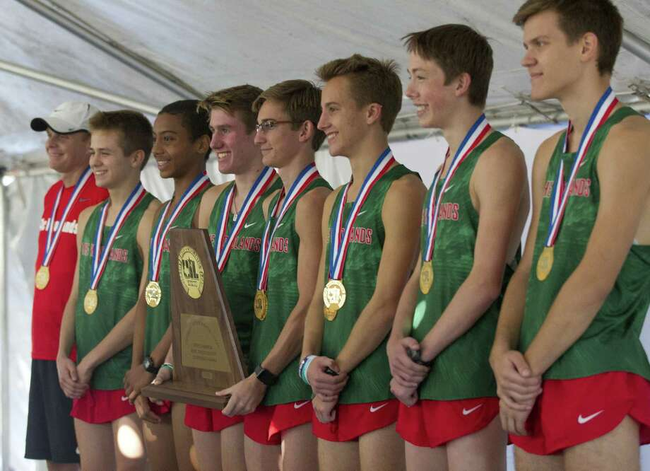 Members of The Woodlands High School varsity cross country team are seen after winning the program's fourth straight team title during the UIL State Cross Country Championships, Saturday, Nov. 3, 2018, in Round Rock. Photo: Jason Fochtman, Houston Chronicle / Staff Photographer / © 2018 Houston Chronicle