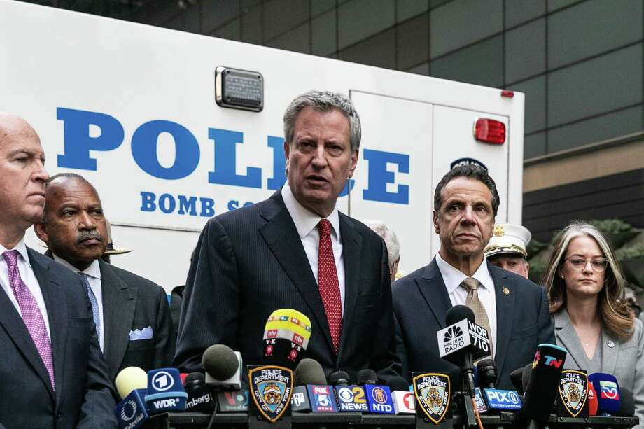 Mayor Bill de Blasio, center, alongside Gov. Andrew Cuomo, and Police Commissioner James O'Neill, left, during a news conference to address the discovery of an explosive device at the CNN offices, in New York, Oct. 24, 2018. Explosive devices were sent to former President Barack Obama and former Secretary of State Hillary Clinton, as well as to CNN's offices in New York, sparking an intense investigation on Wednesday into whether a bomber is going after targets that have often been the subject of right-wing ire. (Jeenah Moon/The New York Times) Photo: JEENAH MOON / NYTNS