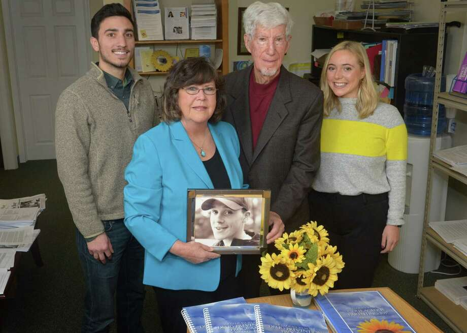 Ginger Katz, CEO and founder of Courage to Speak Foundation, with her husband and co-founder, Larry Katz, and their staff, Program Director Jeff Labella, and Program Coordinator Sydney Delago at their offices Tuesday, October 30, 2018, in Norwalk, Conn. The Courage To Speak Foundation, which educates parents, teachers and students nationwide about opioid usage and addiction, was founded after Katz's son Ian Eaccarino died of heroin overdose. Photo: Erik Trautmann / Hearst Connecticut Media / Norwalk Hour