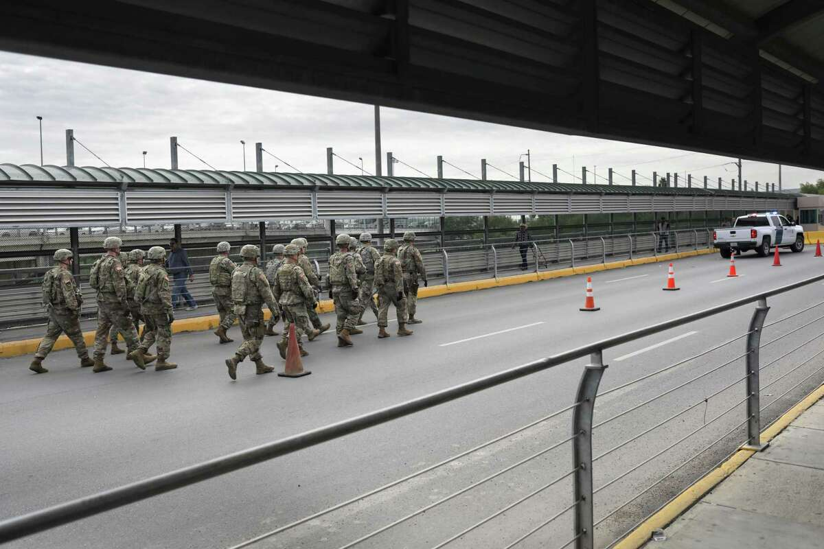 HIDALGO, TX - NOVEMBER 02: U.S. Army soldiers arrive to the international bridge with Mexico on November 2, 2018 in Hidalgo, Texas. U.S. President Donald Trump ordered the troops to the border to bolster security at points where an immigrant caravan may attempt to cross in upcoming weeks. (Photo by John Moore/Getty Images)