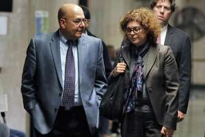 Pat Comunale, father of Joseph Comunale, and one of his attorneys, Elizabeth Kase, leave the courtroom last week.