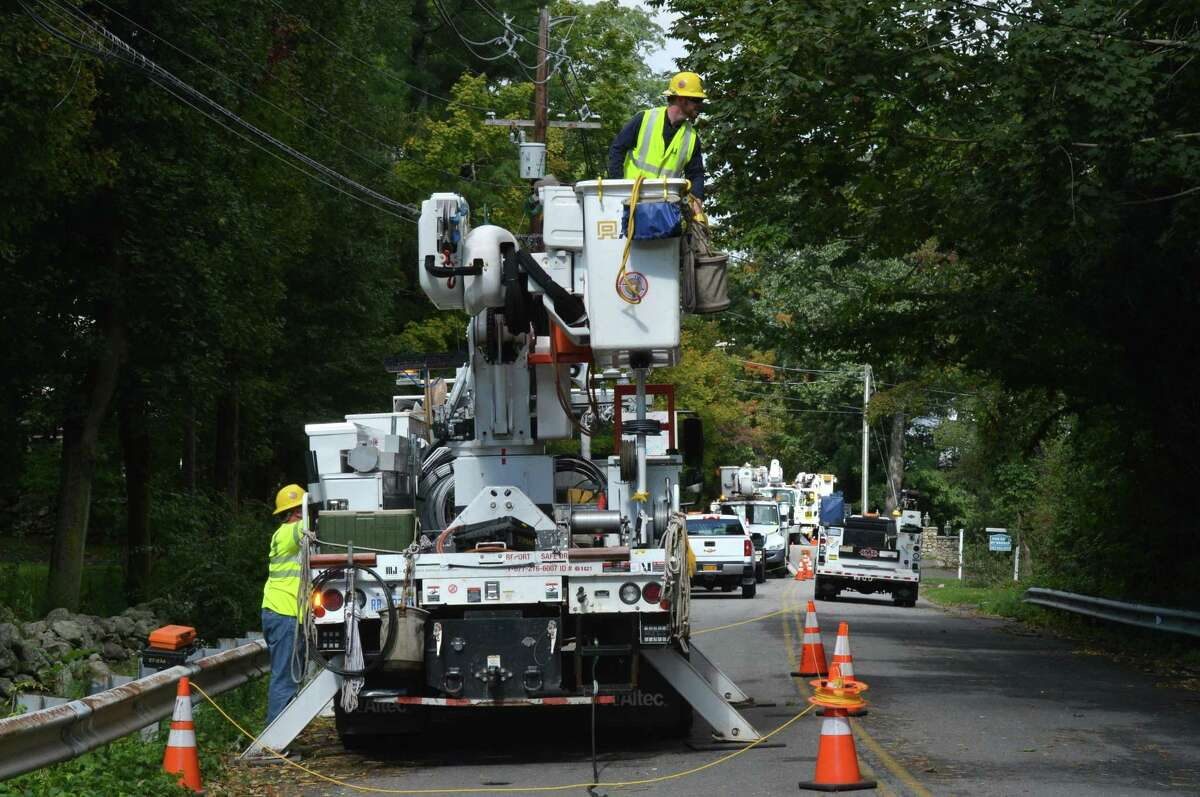 Eversource crews survey and repair damage to the utility lines along West Norwalk Rd. in Norwalk on Wednesday October 3, 2018.