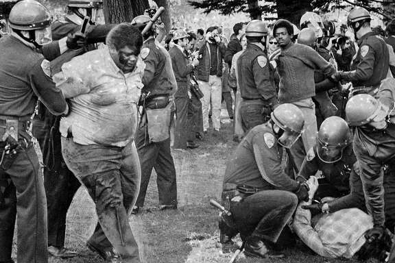 A squad of police waded into the demonstrators in support of a strike to shut San Francisco State college December 3, 1968. Donald McAllister is being led away by two officersPhoto ran 12/8/1968 , This World pg. 5