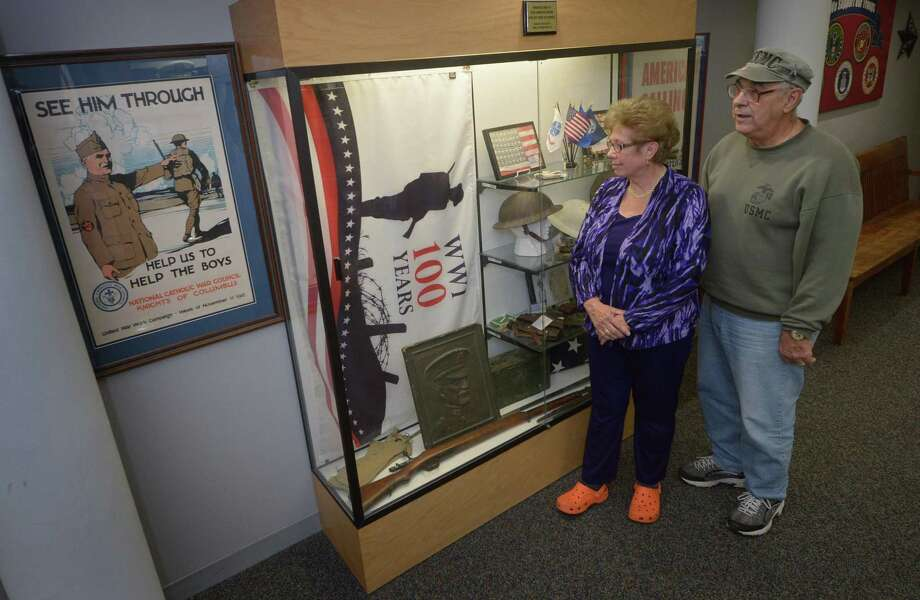 Norwalk Veterans Memorial Committee CFO Karen Doyle Lyons and Chairman Dan Caporale stand next to the the Hall of Honor World War l case denoting the 100th anniversary of the war Thursday, November 1, 2018, in Norwalk, Conn. This year the Norwalk Veterans Day memorial ceremony will honor the 100th anniversary of WWl. Photo: Erik Trautmann / Hearst Connecticut Media / Norwalk Hour