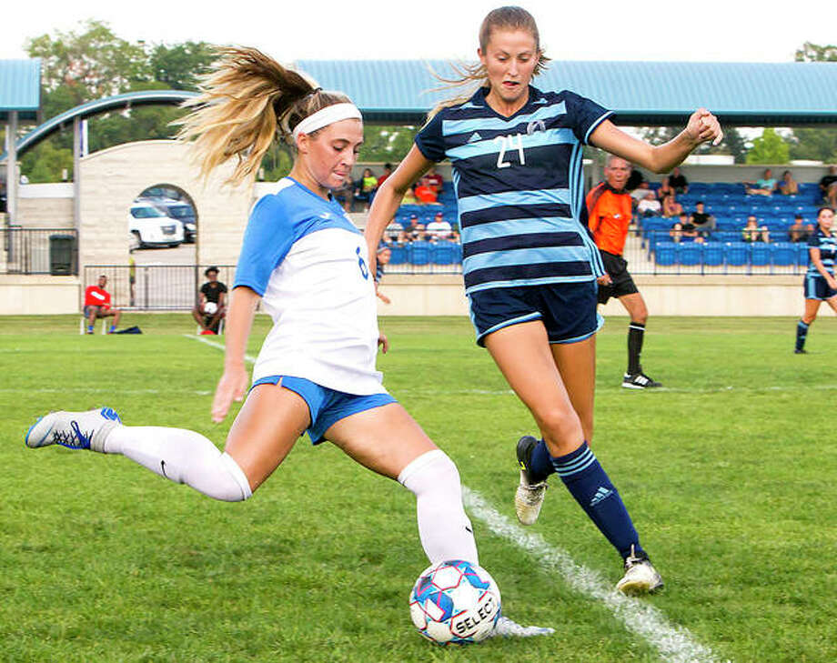 Sydney Schmidt of Lewis and Clark, left, sends to ball upfield during a game this season against St. Louis Community College. Schmidt, a freshman from Alton, has been part of an LCCC defense that has allowed only four goals this season. Photo: Jan Dona | For The Telegraph