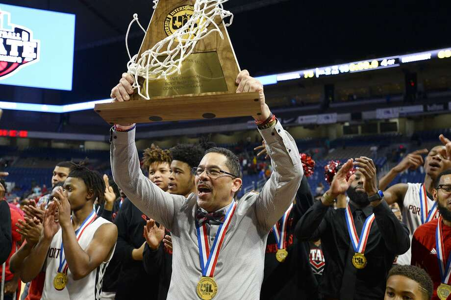 Memorial coach Kenneth Coleman hoists the trophy after the Titans defeated Northwest in the class 5A state final at the Alamodome in San Antonio on March 10, 2018. Photo: Ryan Pelham / Ryan Pelham/The Enterprise / ©2017 The Beaumont Enterprise/Ryan Pelham