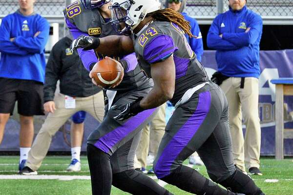 UAlbany QB Jeff Undercuffler, left, hands off to running back #24 Elijah Ibitokun-Hanks during Saturday's Colonial Athletic Association game against Delaware Nov. 3, 2018 in Albany, NY. (John Carl D'Annibale/Times Union)