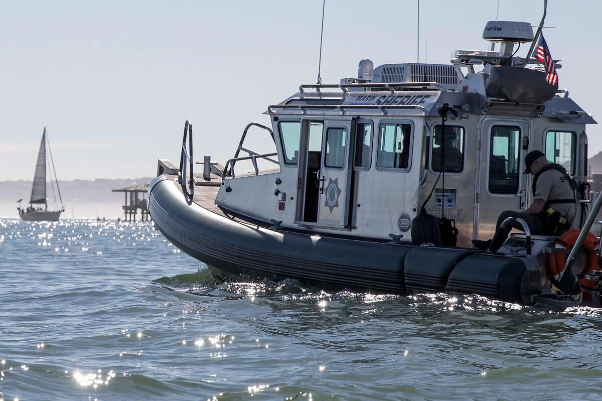 A Marin County Sheriff's boat patrols the waters of Richardson Bay in Sausalito, Calif. Saturday, Nov. 3, 2018.