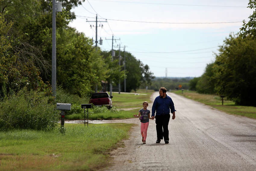 John Holcombe and Evelyn Hill walk to church from their home down the street on Oct. 21. John met Evelyn's mother at the church and it continues to be instrumental in his life.