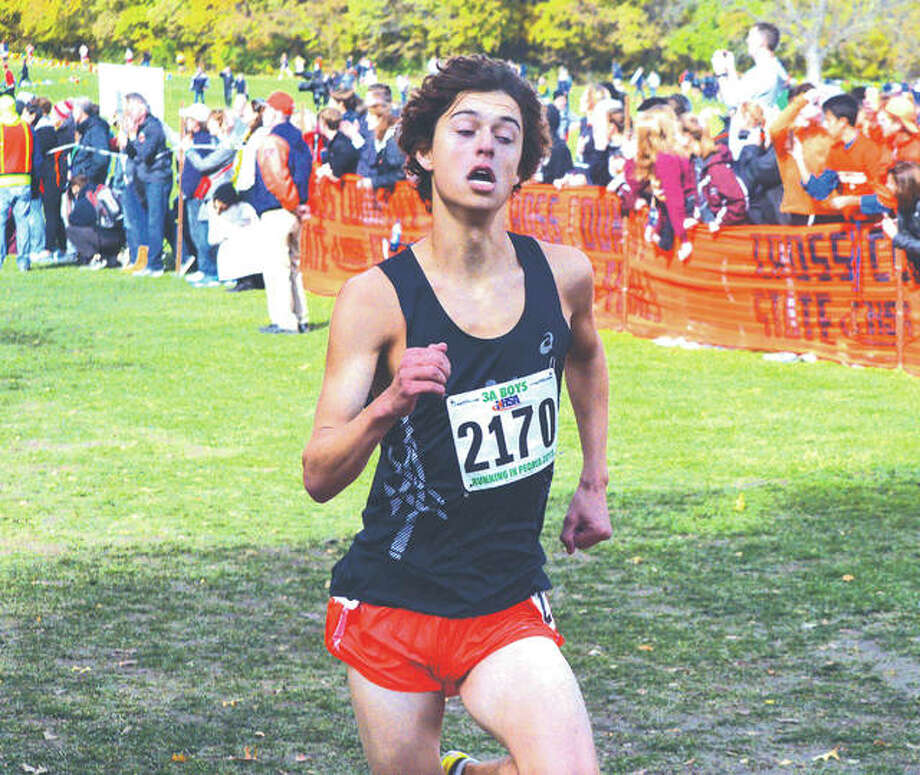 Edwardsville senior Max Hartmann approaches the two-mile mark during Saturday's Class 3A boys' state meet at Detweiller Park in Peoria. Hartmann finished 18th to earn All-State honors. Photo: Scott Marion/Intelligencer