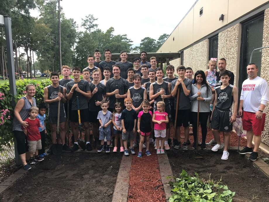 The Hargrave Basketball team helps out with the Garden at Ben Bowen Early Childhood Center Photo: Hargrave Basketball