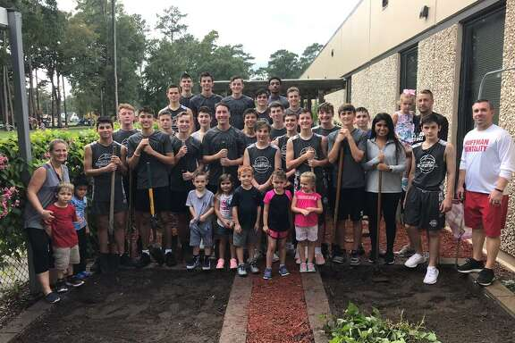 The Hargrave Basketball team helps out with the Garden at Ben Bowen Early Childhood Center