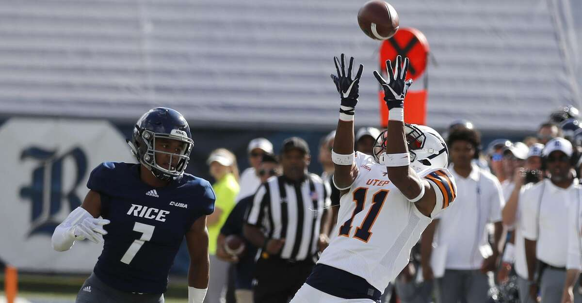 UTEP Miners wide receiver Erik Brown (11) catches a pass against Rice Owls cornerback Justin Bickham (7) during the first half of a college football game at Rice Stadium, Saturday, Nov. 3, 2018, in Houston.