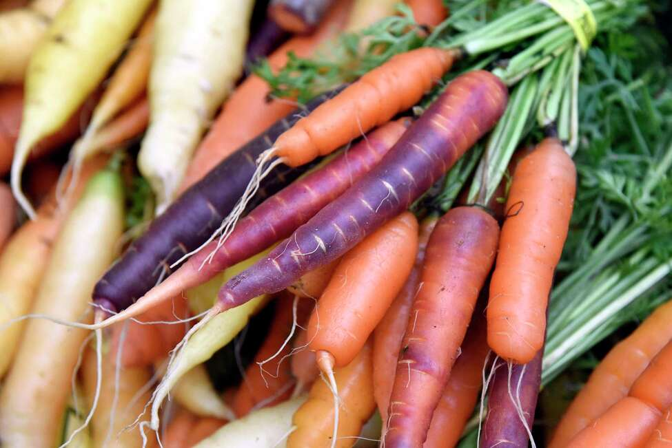 Colorful carrots are for sale at the Our Farm CSA booth during the Troy Waterfront Farmers' Market on Saturday, Nov 5, 2016, at Troy Atrium in Troy, N.Y. This marked the first day of the market moving indoors until April 2017. (Cindy Schultz / Times Union)