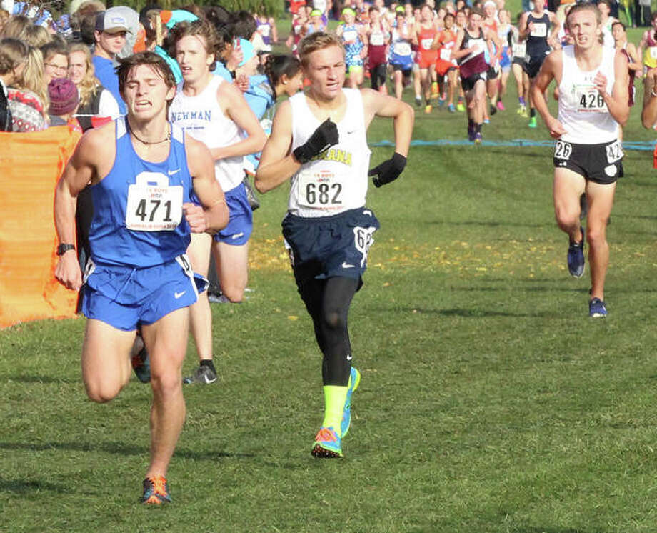 Roxana's Cree Stumpf (682) battles to hold his place in 17th behind Clifton Central's Jeremy Snejberg (right) in the final yards of the Class 1A boys cross country state meet Saturday morning at Detweiller Park in Peoria. Photo: Greg Shashack | The Telegraph