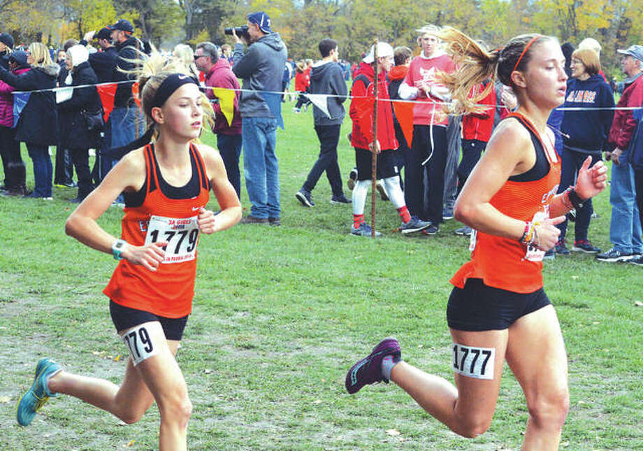 Edwardsville's Makenna Lueking, left, and Elise Krone head toward the two-mile mark during Saturday's Class 3A state meet at Detweiller Park in Peoria. Photo: Scott Maron/Intelligencer