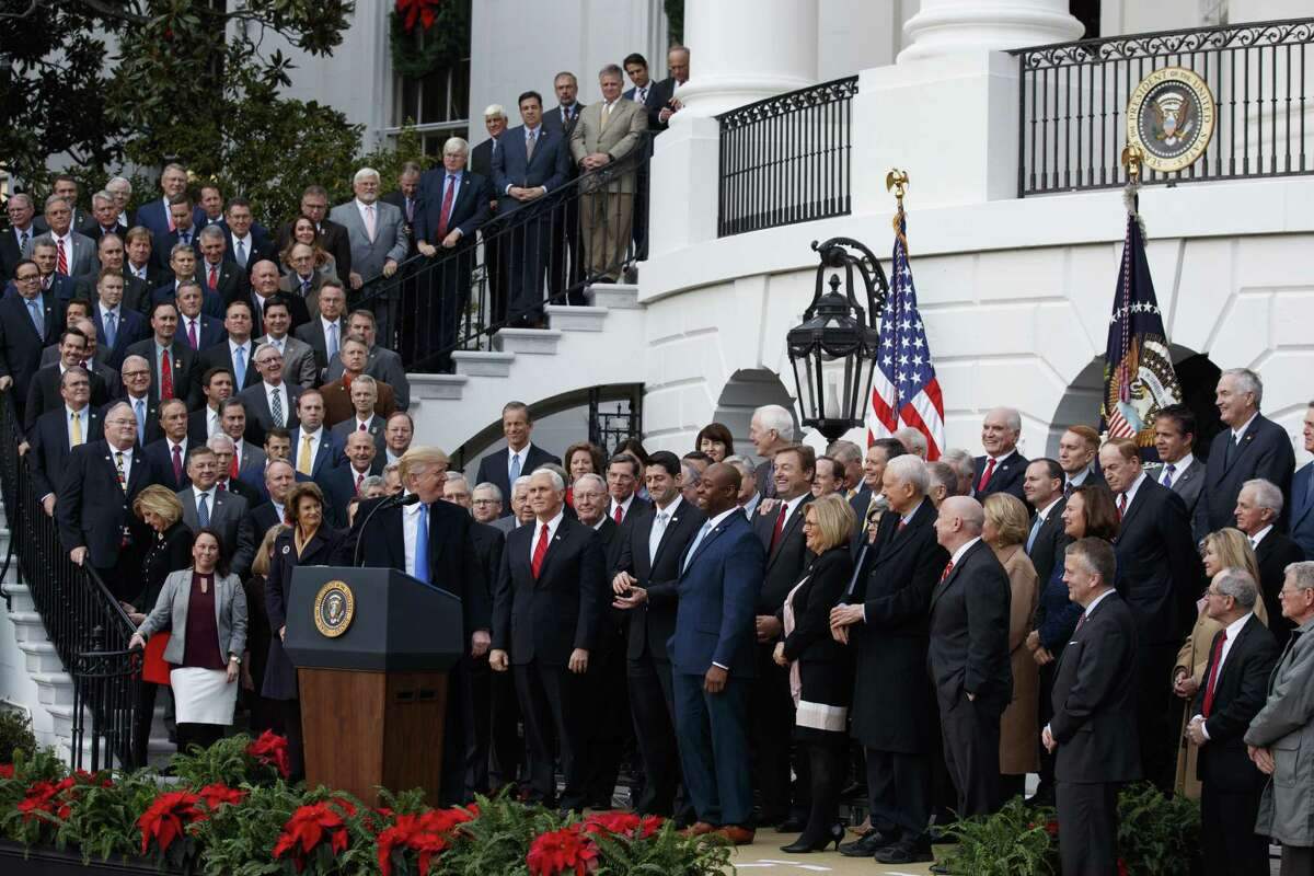 FILE - In this Dec. 20, 2017 file photo, President Donald Trump speaks during an event on the South Lawn of the White House in Washington, to acknowledge the final passage of tax overhaul legislation by Congress. Perhaps nowhere is the choice facing voters more vivid than in the battle for control of the House, where Democrats are fielding more women and female minority candidates than ever while Republicans are trying to hold the majority with mostly white men. The disparity highlights a trend that has been amplified under President Donald Trump, with the two parties increasingly polarized along racial and gender lines as much as by the issues. (AP Photo/Evan Vucci)
