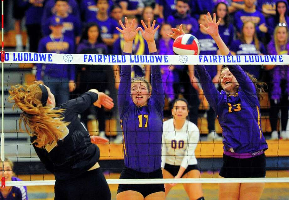 Westhill's Sophia Thagouras (17), center, and Betsy Sachs (13) try to block a spike by Trumbull's Krystina Schueler during FCIAC girls volleyball championship action at Fairfield Ludlowe High in Fairfield, Conn. on Saturday, Nov. 3, 2018. Photo: Christian Abraham / Hearst Connecticut Media / Connecticut Post