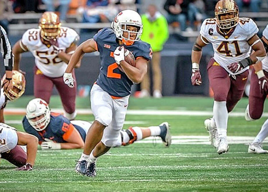 Reggie Corbin of Illinois (2) picks up yardage during Saturday's game against Minnesota at Memorial Stadium in Champaign. Photo: Illini Athletics