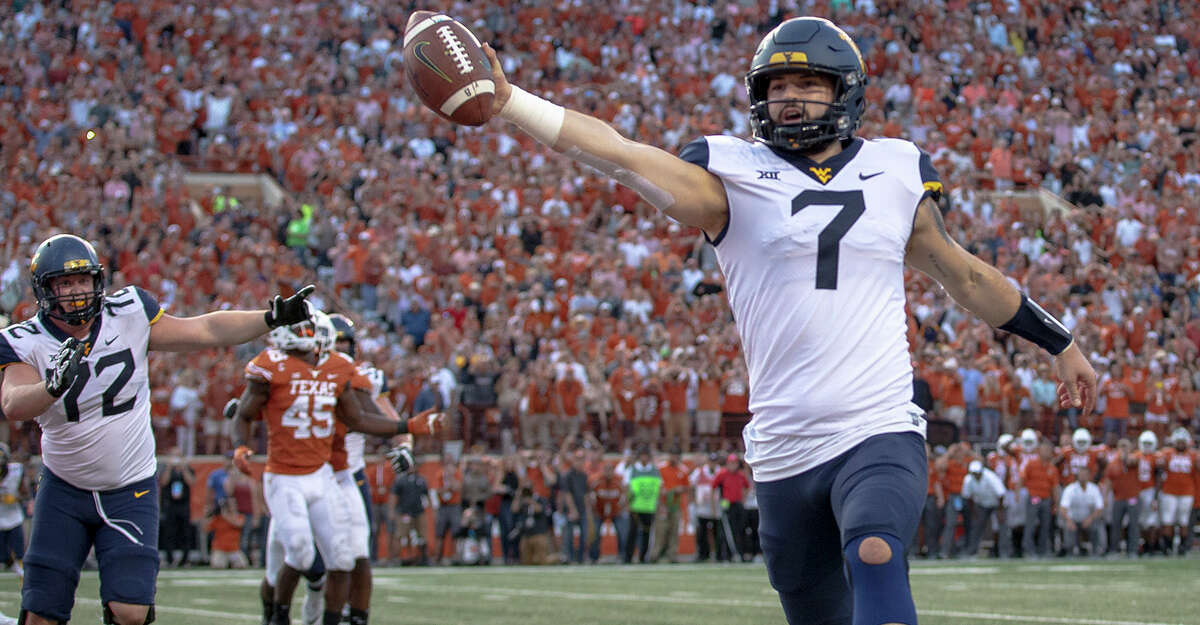 West Virginia quarterback Will Grier (7) scores the game-winning two-point conversion during an NCAA college football game against Texas.