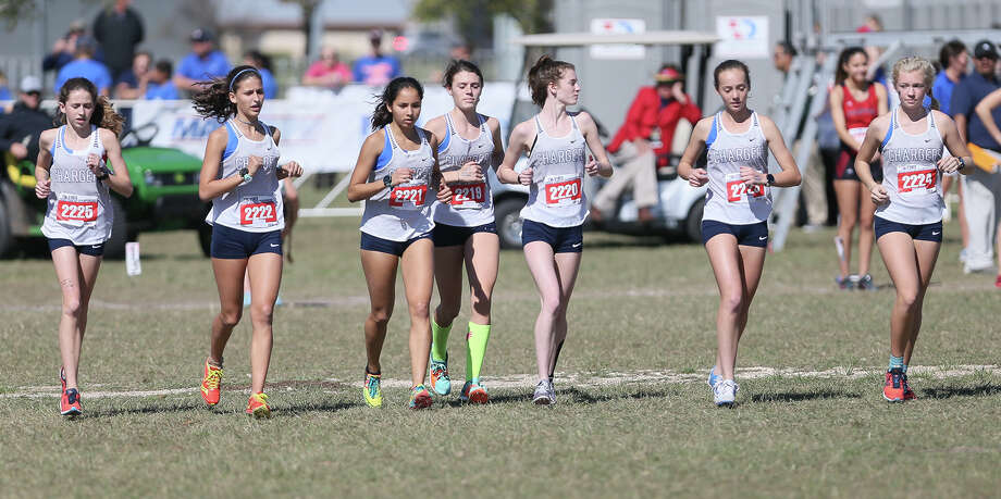 iThe Boerne Champion girls team: Kate Williams (from left), Katie Houck, Anastacia Gonzales, Savana Alt, Erin Briley, Elle Shrader and Kelsie Vicknair runs out during introductions prior to the start of the 5A Girls 5K during the UIL state cross country championships at Old Settlers Park in Round Rock on Saturday, Nov. 3, 2018.  The Chargers finished second at the meet. Photo: Marvin Pfeiffer / Express-News 2018