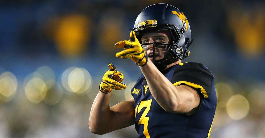 MORGANTOWN, WV - OCTOBER 25:  David Sills V #13 of the West Virginia Mountaineers reacts after a first down in the first half against the Baylor Bears at Mountaineer Field on October 25, 2018 in Morgantown, West Virginia.  (Photo by Justin K. Aller/Getty Images) Photo: Justin K. Aller/Getty Images