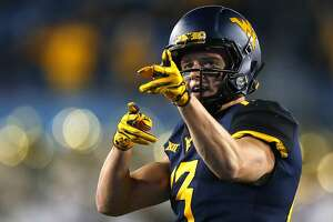 MORGANTOWN, WV - OCTOBER 25:  David Sills V #13 of the West Virginia Mountaineers reacts after a first down in the first half against the Baylor Bears at Mountaineer Field on October 25, 2018 in Morgantown, West Virginia.  (Photo by Justin K. Aller/Getty Images)