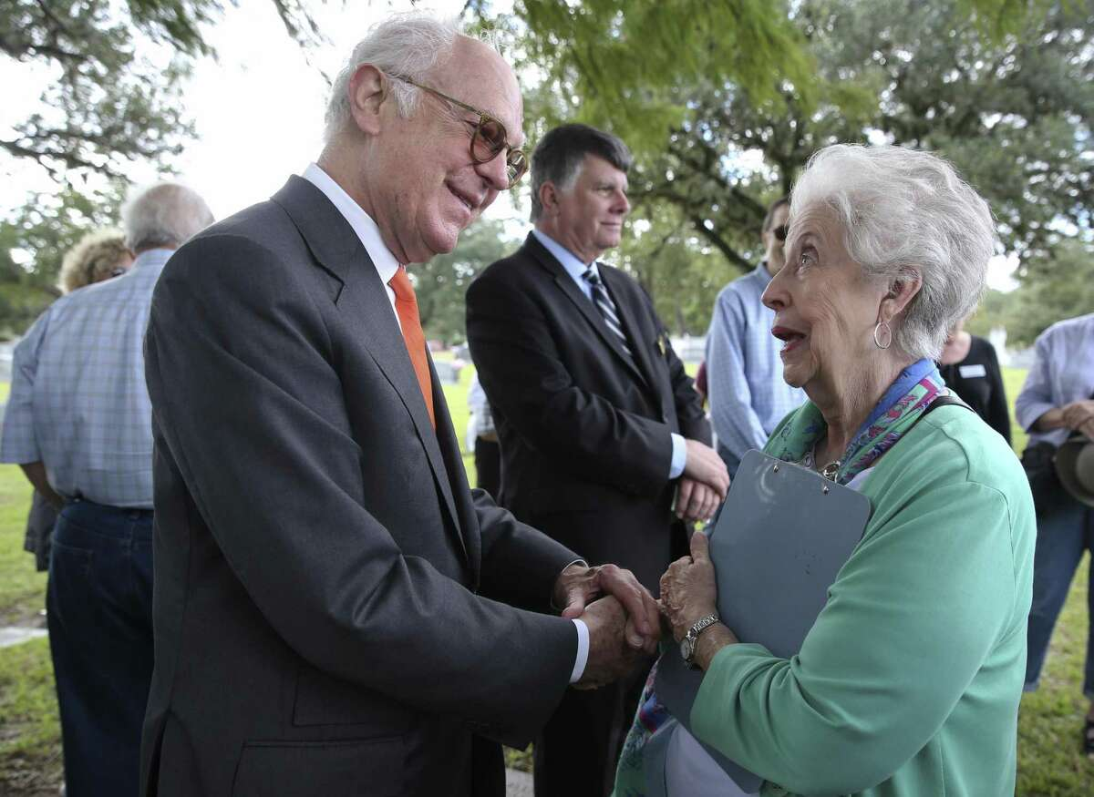 Francois de Menil, left, son of Dominique de Menil, talks to Houston historian Betty Chapman during a heritage tour at Forest Park Lawndale Cemetery on Saturday, Nov. 3, 2018, in Houston. The tour visited two cemeteries and learned history of women who made impact in Houston. Chapman told de Menil that her husband was the official who naturalized the de Menil family.